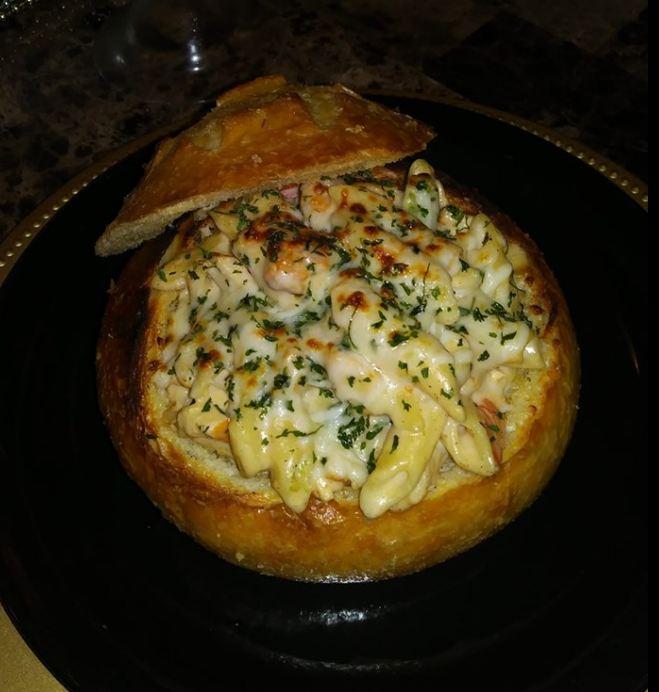 Blackened shrimp, chicken, broccoli Alfredo in butter garlic bread bowl