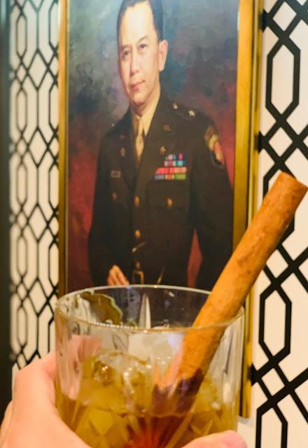 Carlos P Romulo portrait & Don Papa rum cocktail
