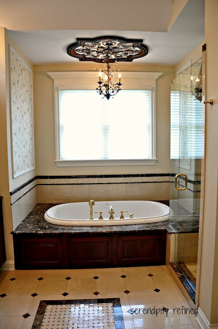 Dark Wood Master Bathroom Cabinets, Sconces, Mirrors Tile, Glass Shelves, Crema Marfil Marble, Emperador Dark Granite, shower, tile rug, mosaic, tub surround