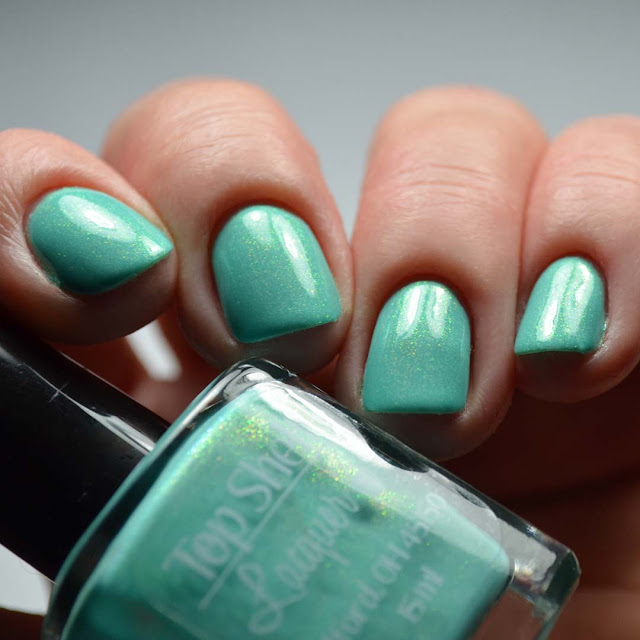 teal shimmer nail polish low light swatch