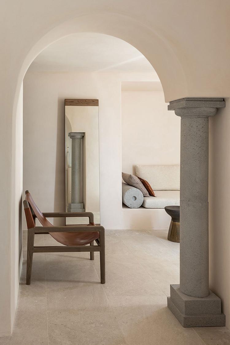 ISTORIA Boutique Hotel designed by Interior Design Laboratorium. Photo by Giorgos Sfakianakis. Built-in daybed, contemporary minimalistic interior, modern rustic bedroom, boutique hotel in Santorini, designer hotel in Santorini