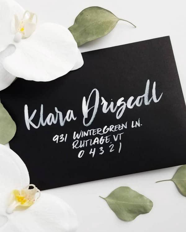 white ink hand lettered black envelope