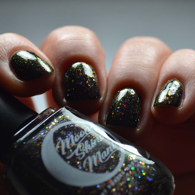 black jelly nail polish with color shifting flakies and glitter swatch
