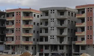 إيران تنفي تمويل مشاريع بناء وحدات سكنية في سوريا