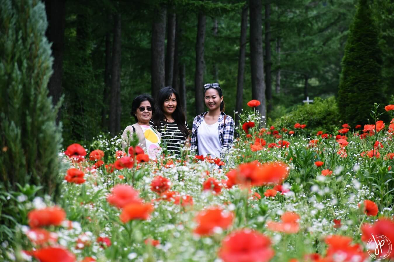 three ladies and red flowers