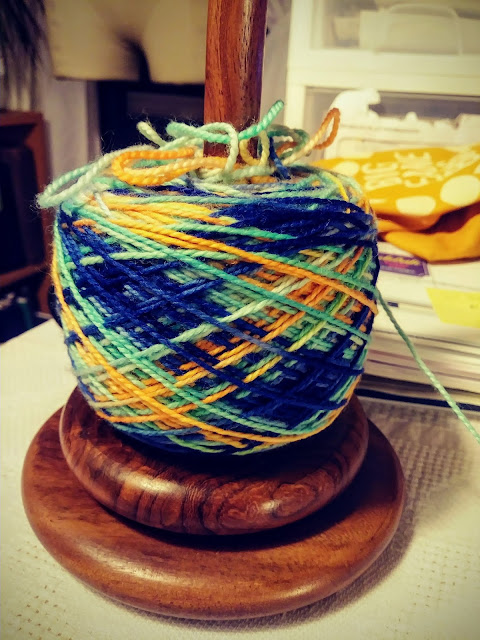 fingering weight yarn, pooled on the spool