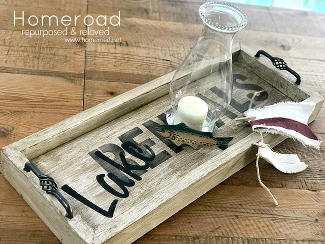 Rustic tray with a lakehouse rental stencil