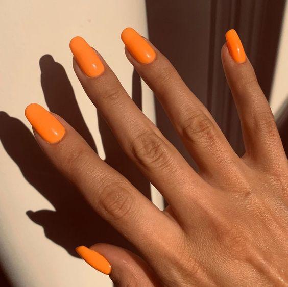 Selena Gomez bright orange nails