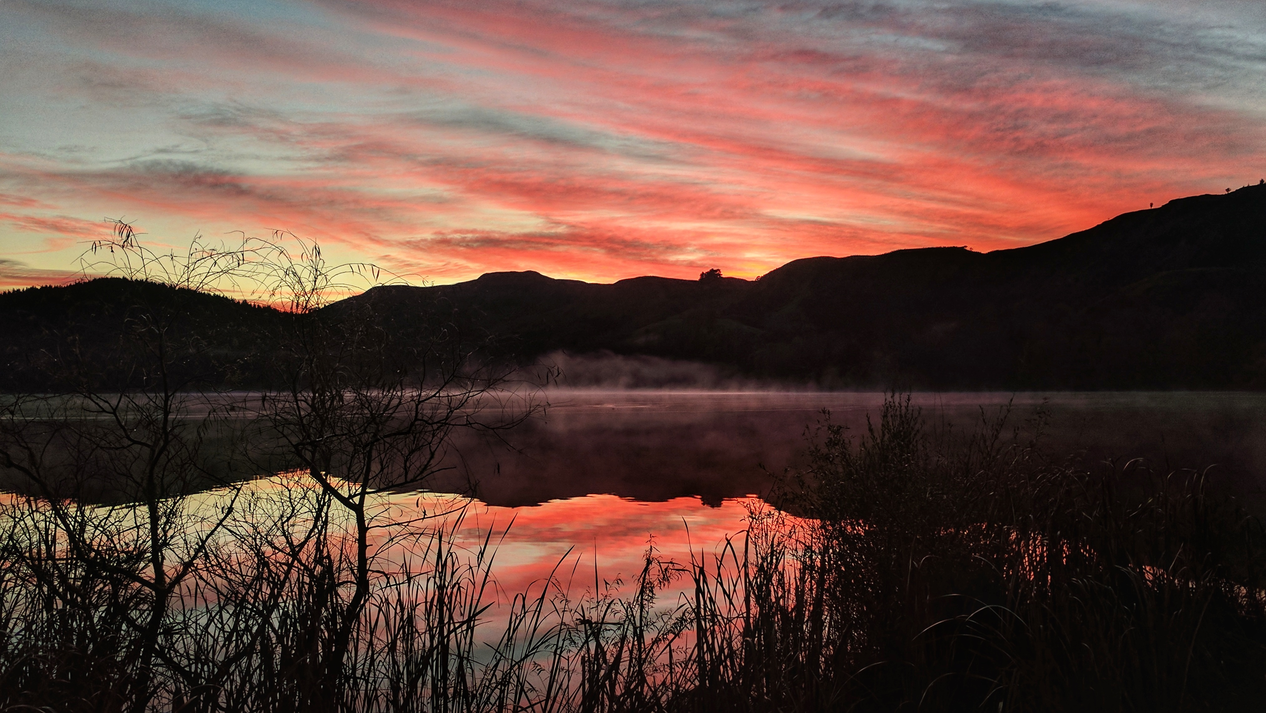 Landscape sunrise over Lake Tutira (Aotearoa New Zealand)