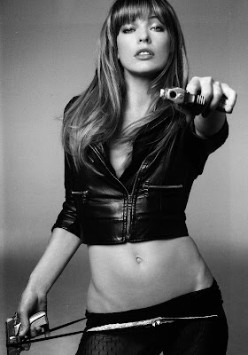 Milla Jovovich pointing gun at viewer