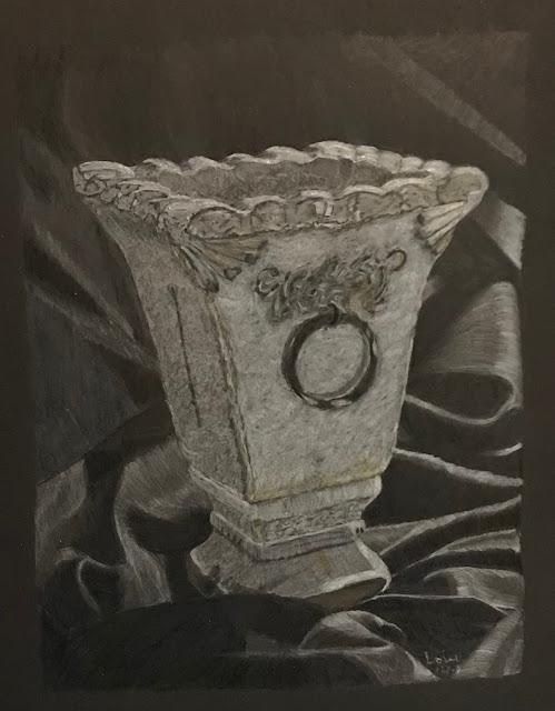 still life drawing of grey pot standing on draped black fabric, Faber-Castell Polychromos pencils on black paper, artist Linzé Brandon