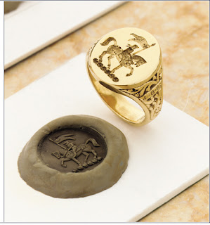 Red Signet Ring On A Swan