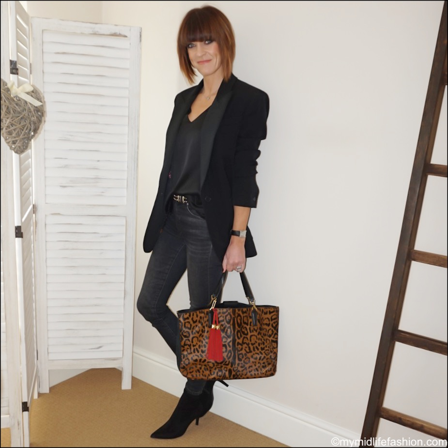 my midlife fashion, Isabel Marant oversized tuxedo jacket, marks and Spencer pure silk v neck sleeveless blouse, marks and Spencer stiletto heel velvet ankle boots, j crew 9 high rise toothpick jean in charcoal, Brian Atwood leopard print tote