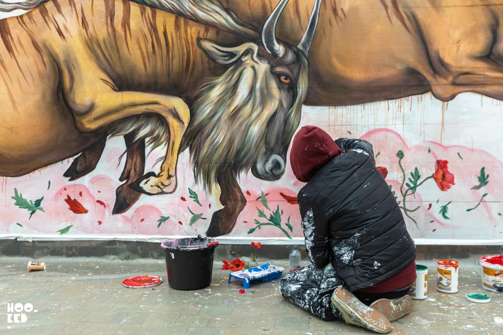 Street Artist Mateus Bailon at work on a Mural in Ostend, Belgium