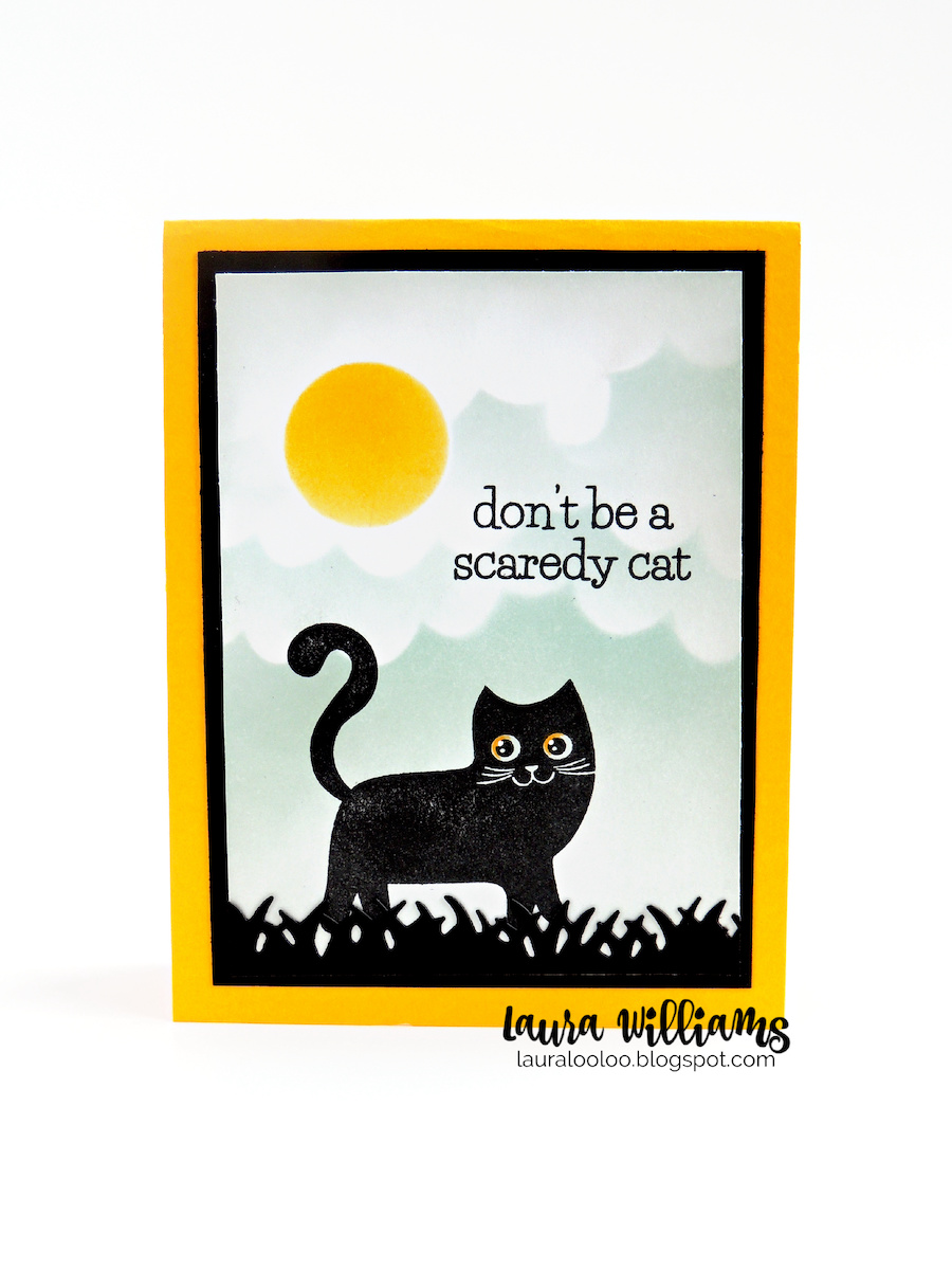 """This image is a handmade Halloween card with a stamped cat in black ink. The cat is standing in black grass under a cloudy moonlit sky, created with inking and handmade stencils. The sentiment says """"Don't be a scaredy cat."""""""
