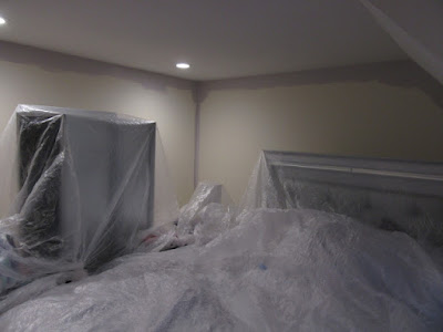 before image of bedroom being prepped and painted.