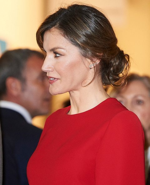 Queen Letizia carried Carolina Herrera Animal Print Clutch Bag and she wore Magrit Boots, red skirt and red blouse