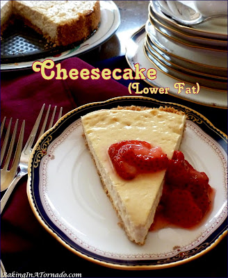 This Cheesecake is lower in fat but just as creamy and delicious as the full fat version. Serve as is or top with fruit of your choice. | Recipe developed by www.BakingInATornado.com | #recipe #dessert