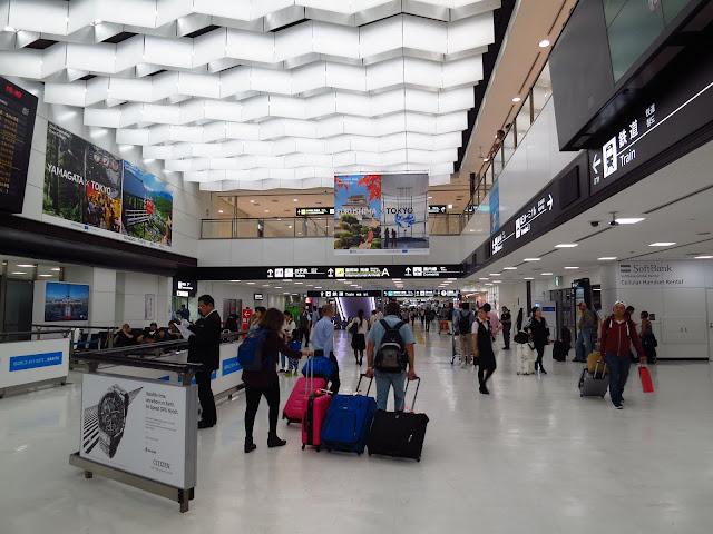 Backpackers at Japan Narita Airport. Tokyo Consult. TokyoConsult.