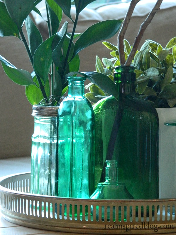 Decorating from the Yard with antique green bottles, sticks, and leaf cuttings