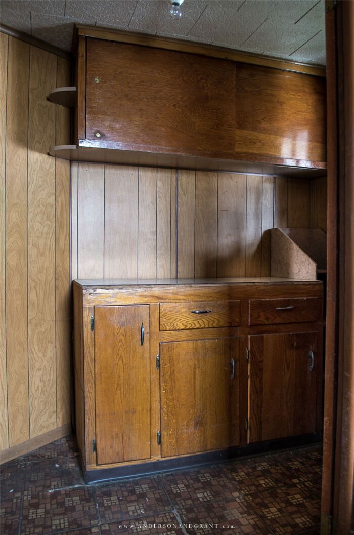 Entryway with cupboards and dated paneling