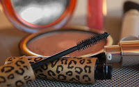 an opened mascara & its lid