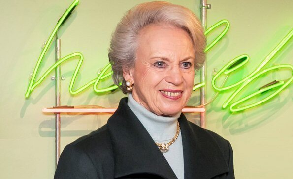 Princess Benedikte wore a green wool cashmere coat, and blue cashmere sweater, and gold diamond necklace. The Princess wore black leather boots