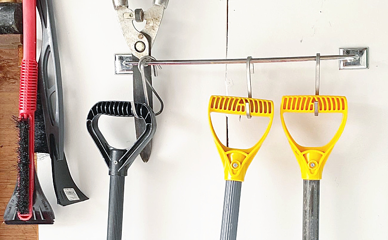 tools hanging on a towel bar