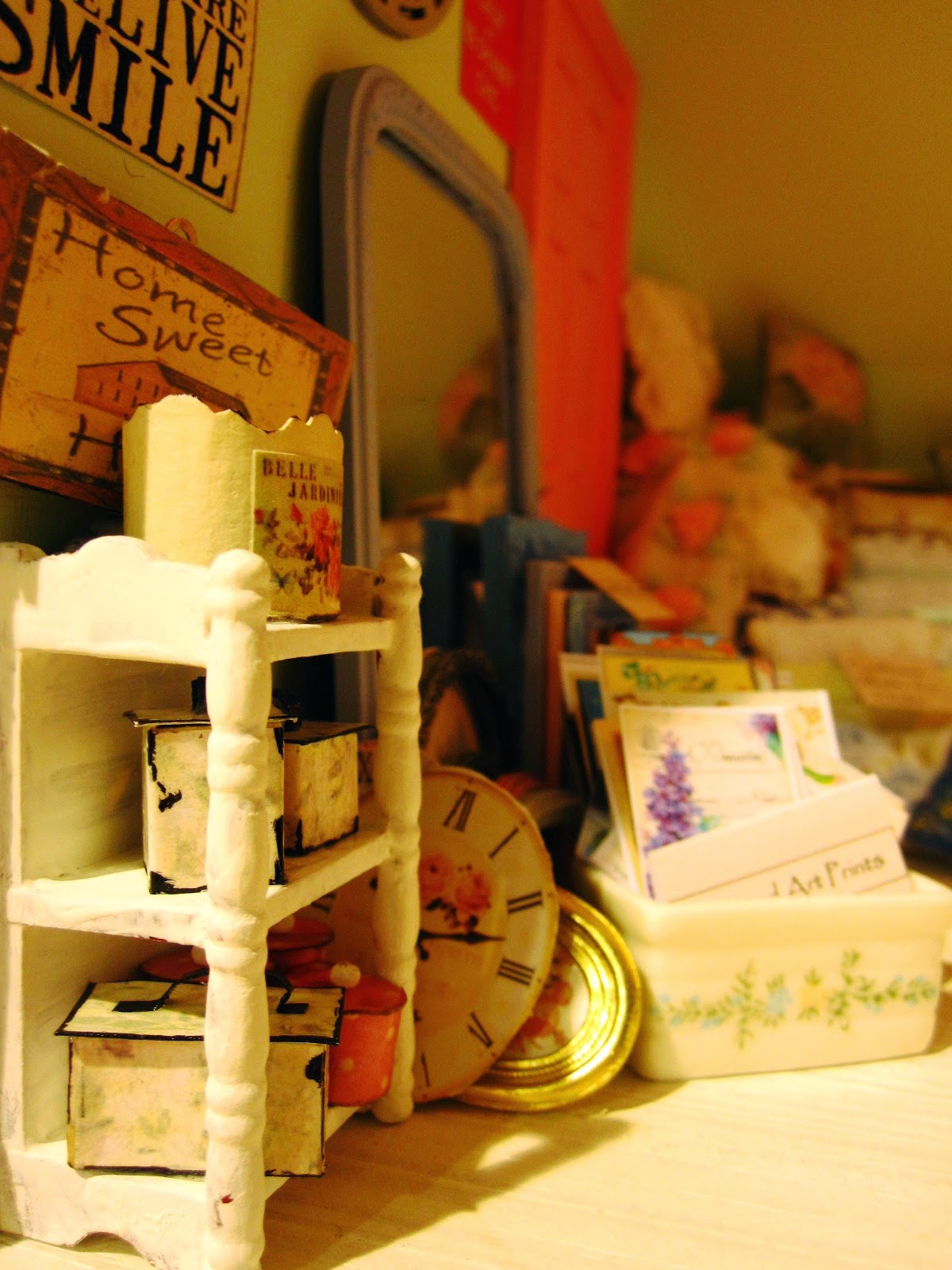 Modern miniature shabby chic shop close up with display shelves, wall pictures and sot furnishings.