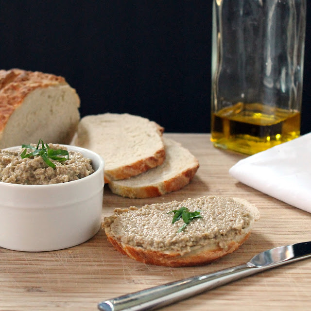 Roasted Eggplant and Garlic Spread over a slice of bread.