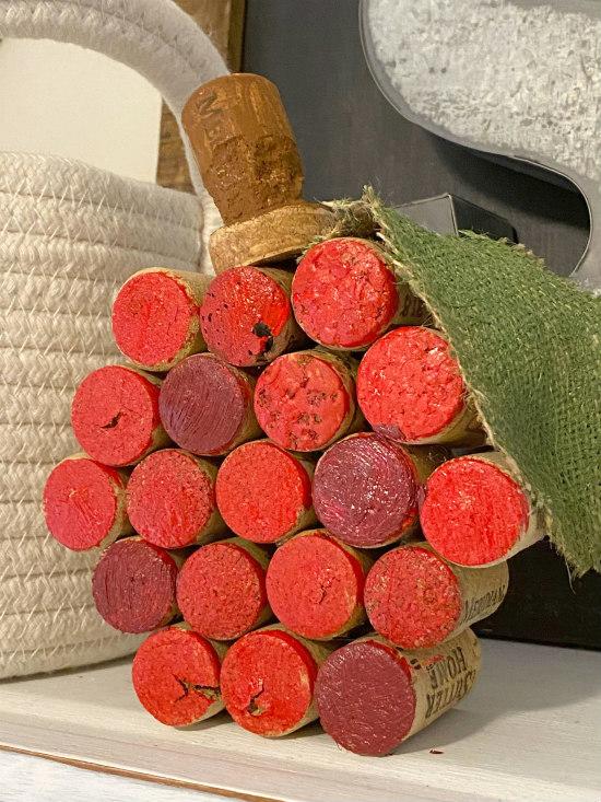 wine cork apple on shelf