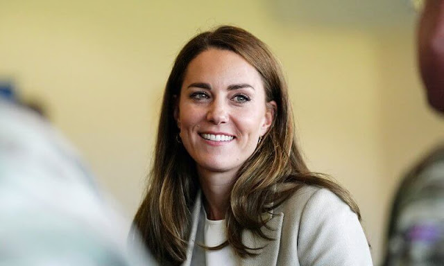 Kate Middleton wore a new double-breasted blazer by Reiss Larsson, and high waisted sport luxe trousers by Jigsaw