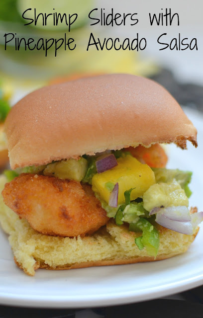 A simple and delicious dinner or appetizer idea! Full of fresh flavors and completely satisfying! Shrimp Sliders with Pineapple Avocado Salsa Recipe from Hot Eats and Cool Reads