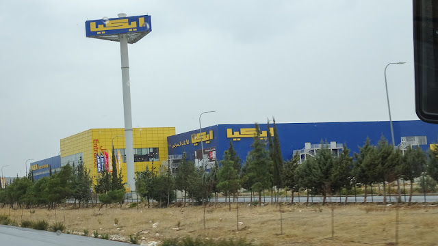 On the way from the airport, its the first building