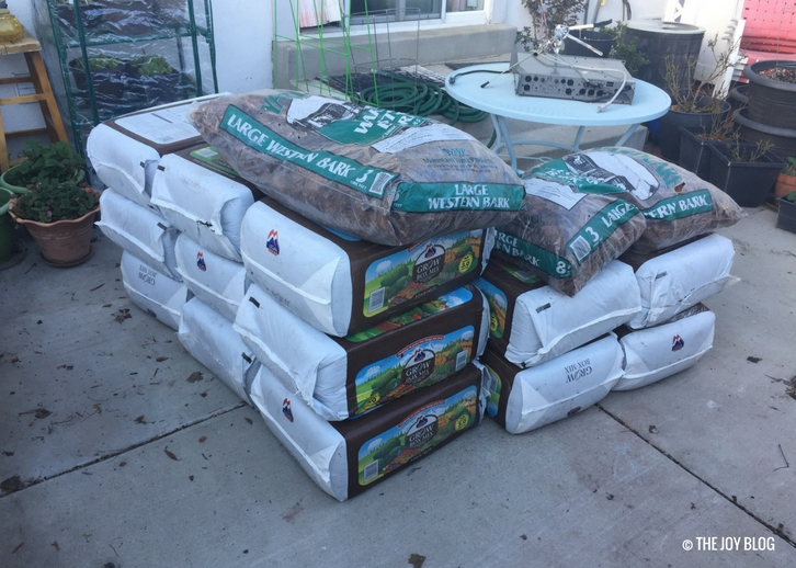 A stack of grow box mix soil for raised beds and garden boxes. // www.thejoyblog.net