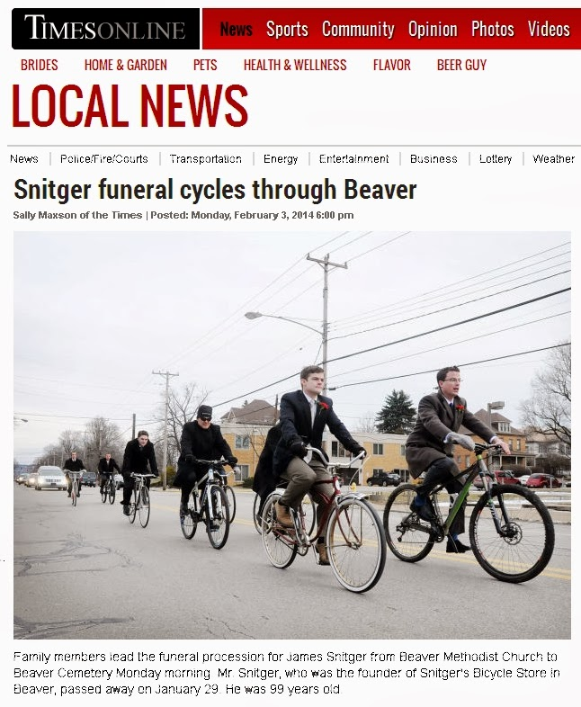 Family members on bicycles lead the funeral procession for Mr. James Snitger, 99, in Beaver PA on Monday morning. Mr. Snitger was the founder of Snitger's Bicycles in Beaver, PA.