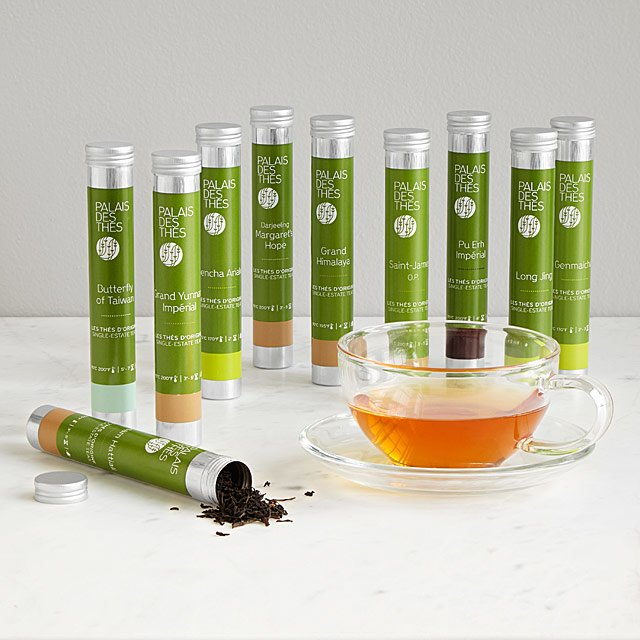 Ten silver tubes of loose leaf tea from around the World