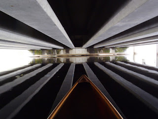 Illusion of freeway girders beneath as well as above canoe, Nigel Foster