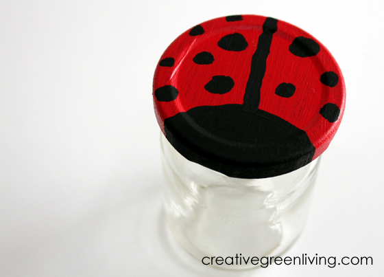 Jar lid painted to look like a ladybug