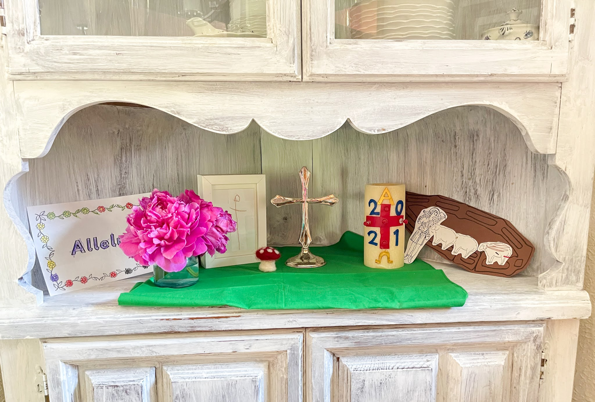 Here's a look at our Catechesis of the Good Shepherd and Montessori inspired children's prayer area in our Montessori home.
