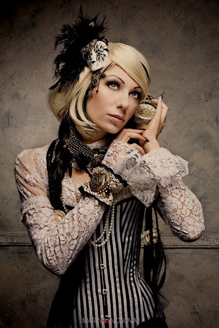 Neo-Victorian fashion for steampunk clothing and costumes. White lace blouse, striped corset, feather fascinator and jewelry