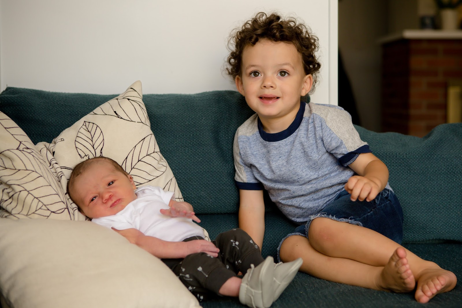 newborn baby brother and big brother
