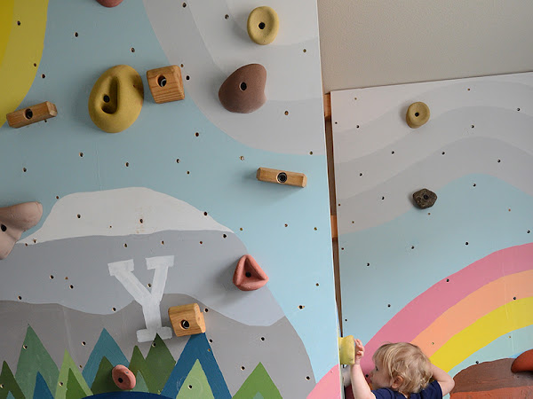 Kids Inside Rock Climbing Wall with Mural