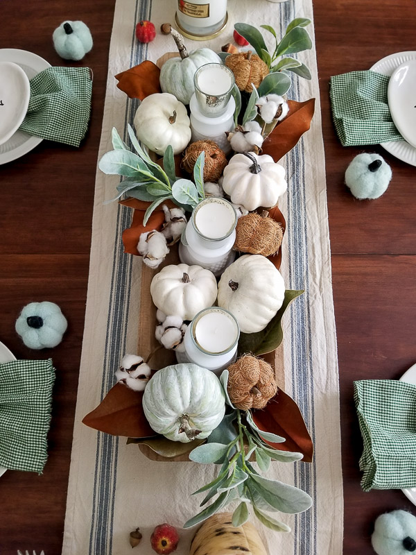 Fall table centerpiece with pumpkins