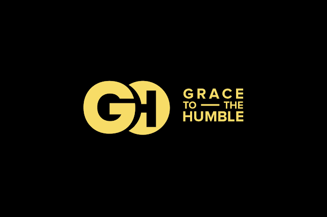 Grace to the Humble Logo showing gold text with a black background