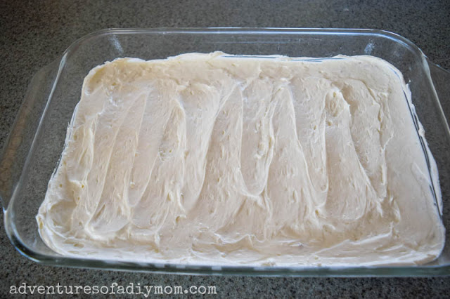 adding cream layer to peach dessert