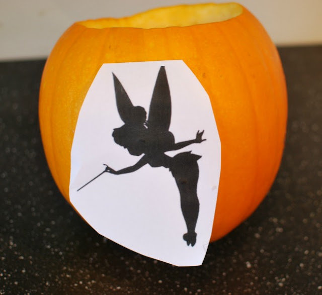Pumpkin with Tinkerbell template stuck on it