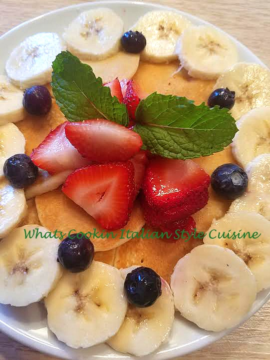 Red White and Blue appetizer breakfast with homemade pancakes using blueberries, strawberries and bananas for a patriotic festive themed look for the 4th of July or Memorial Day Parties