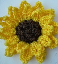 http://www.ravelry.com/patterns/library/decorative-sunflower