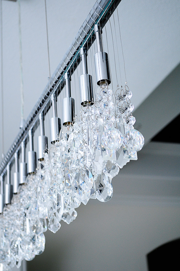 13-Light Linear Crystal Chandellier Review: Our lighting choices for our new home. Learn how we saved $1000. | via monicawantsit.com